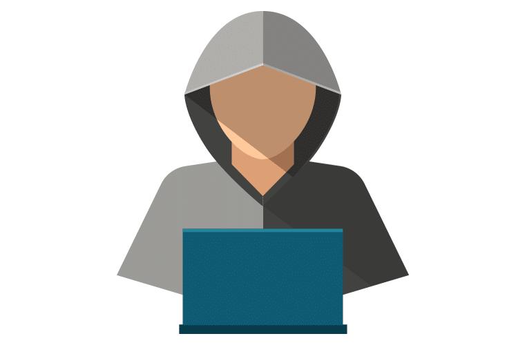 Shady looking character at a laptop