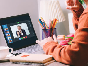 Person sitting at desk video conferencing